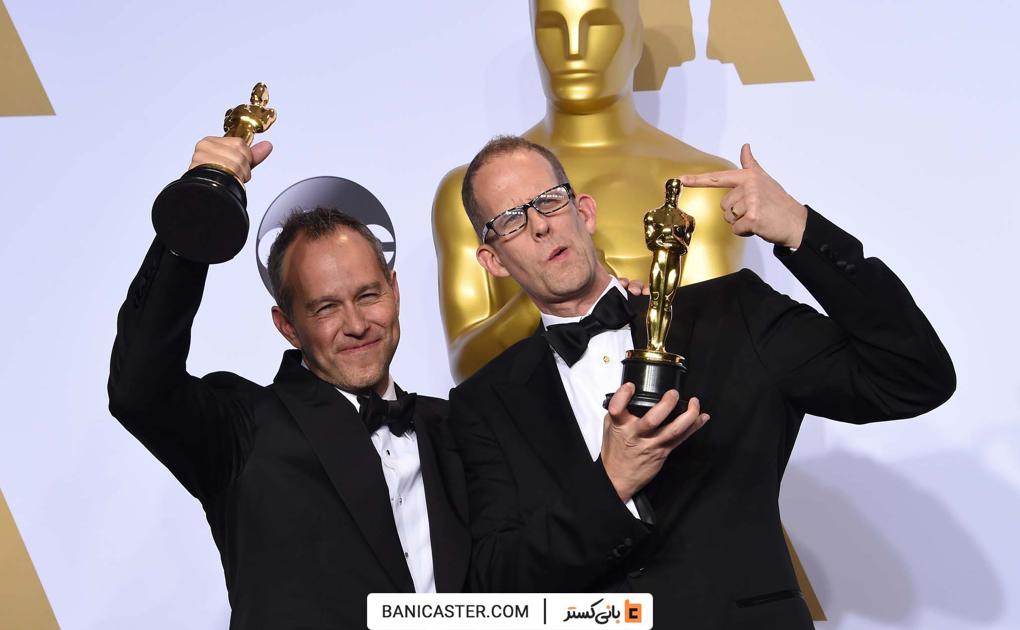 """Pete Docter (R) and Jonas Rivera pose with their Oscar for Best Animated Feature Film, """"Inside Out,"""" in the press room during the 88th Oscars in Hollywood on February 28, 2016. AFP PHOTO/FREDERIC J. BROWN / AFP / FREDERIC J. BROWN (Photo credit should read FREDERIC J. BROWN/AFP/Getty Images)"""